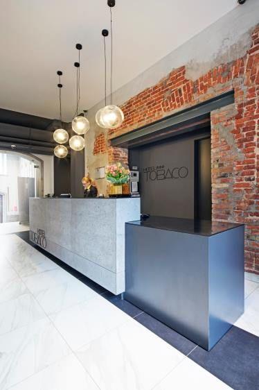 receptie design interior caramida beton stil industrial modern